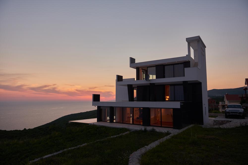 External view of a contemporary house modern villa at  sunset